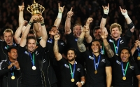 AUCKLAND, NEW ZEALAND - OCTOBER 23: Richie McCaw of the All Blacks lifts the Webb Ellis Cup as team mates celebrate after the 2011 IRB Rugby World Cup Final match between France and New Zealand at Eden Park on October 23, 2011 in Auckland, New Zealand. (Photo by Cameron Spencer/Getty Images)